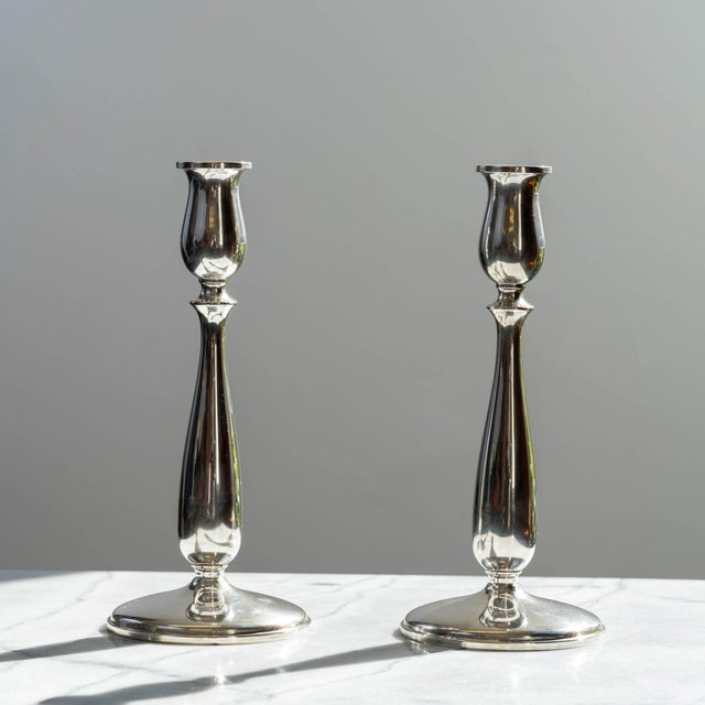 Beautiful pair of vintage sterling silver Cartier candlesticks, New York, circa 1950s! The perfect touch to any dining...