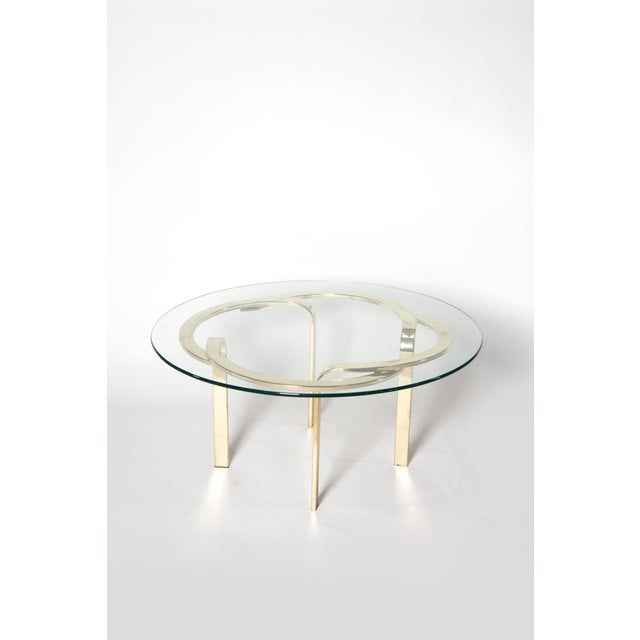 Brass base vintage cocktail table with removable glass top. The base has minimal wear from every day use.
