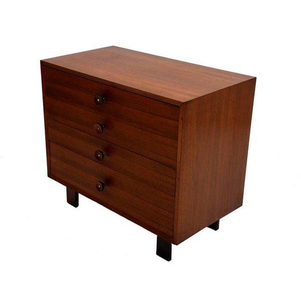 For your consideration a tall dresser designed by George Nelson for Herman Miller. Features four pull out drawers...