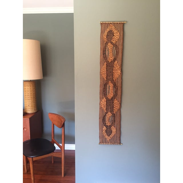 Offering this very cool biomorphic woven wall hanging. The weave is held together by 2 brass rods. These rods are not...