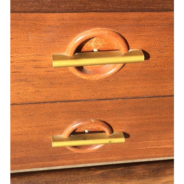 A pair of Mid-century modern walnut side tables by Basset Furniture. Double drawers with unique handles combine style with...