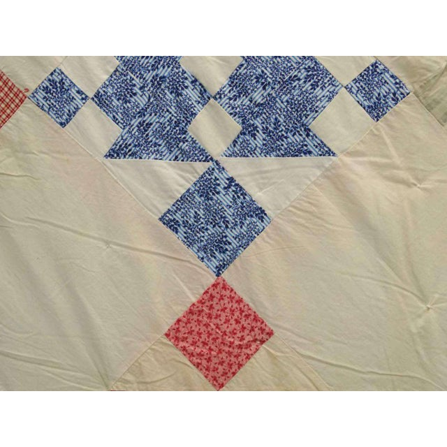 """I'm selling a vintage hand stitched quilt. The base color is white with multi colored geometric design. Dimensions: 68"""" by..."""