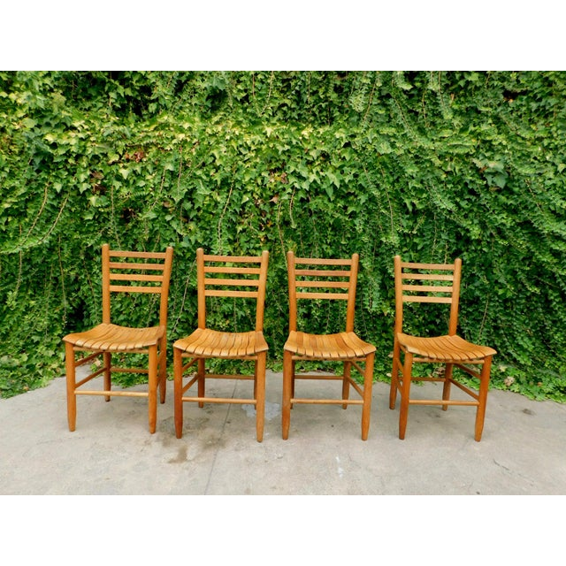 Beautiful set of four Arthur Umanoff style dining chairs. Chairs are super solid condition, and have a fun mix of farm...