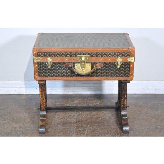 Incorporate high style and functionality into your interior design with antique luggage from French luxury brand Goyard...