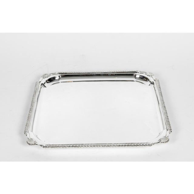 English silver plate barware / serving footed tray with bordered design details. The is in excellent condition, maker's...