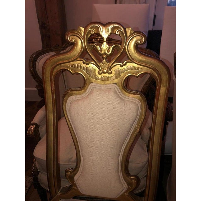 A pair of heartbreakingly pretty vintage super elegant authentic original gold gilt chairs in excellent condition, with...
