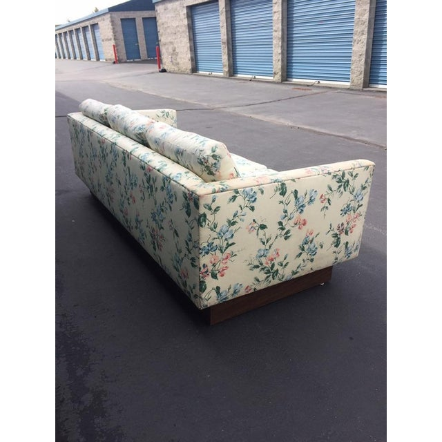 Mid Century Modern Milo Baughman Walnut Plynth base Sofa - This three -seat Mid-Century sofa is covered with a yellow...