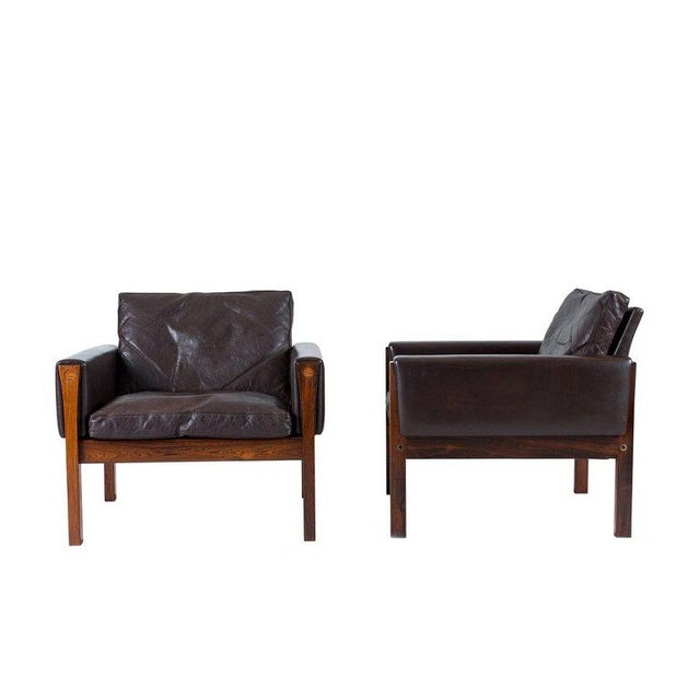 Pair of Hans Wegner AP 62 lounge chairs designed in 1960 and produced by A. P. Stolen.