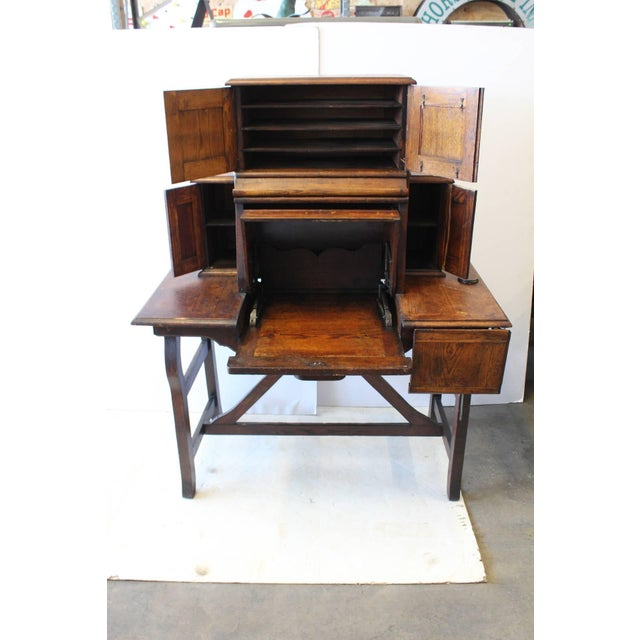 Rare antique American Industrial mechanical desk. By pulling central drawer whole desk will open.