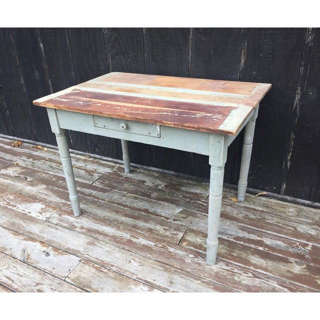 Rustic, distressed farm table found on a centennial farm in NW Michigan. We think this would look great as a breakfast...