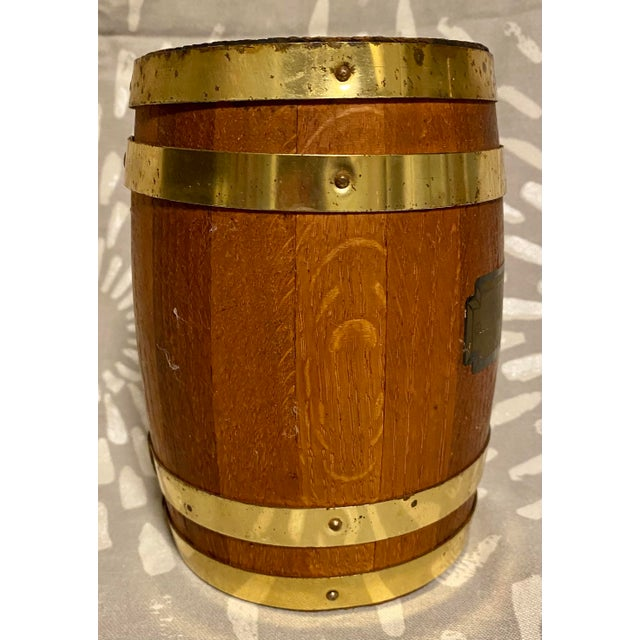 This is a collectible coin bank in the share of barrel from St. Louis County National Bank from the late 1940s. This bank...