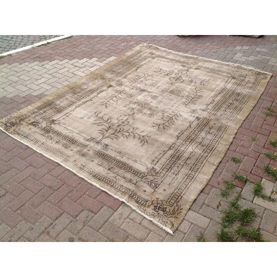 This gorgeous hand knotted area rug is made in 1920's by Anatolian tribals. Collectible rug is made with all hand spun...
