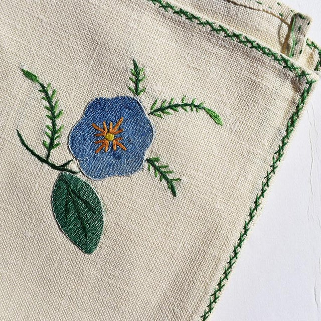 Set of 6 hand-embroidered cloth napkins. Each napkin is hand embroidered with fabric and thread into beautiful flowers....