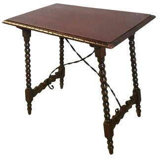 Spanish Baroque Side Table With Iron Stretcher and Carved Top in Walnut For Sale