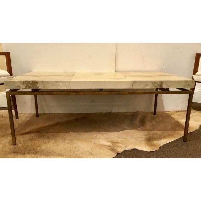 Stylish modern Interlude Home Hampton Coffee Table, vellum top, antique brass base, showroom floor sample