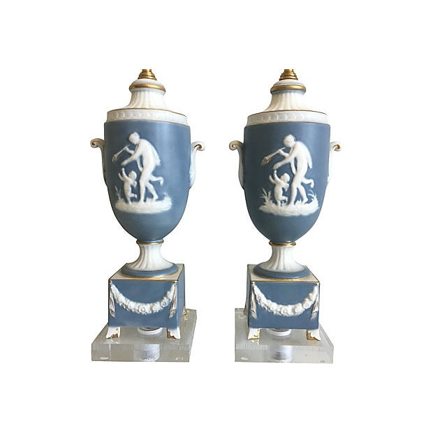 Stunning and rare pair of 1950s Italian Wedgwood blue Jasperware handled urn lamps of bisque porcelain giving a cameo...