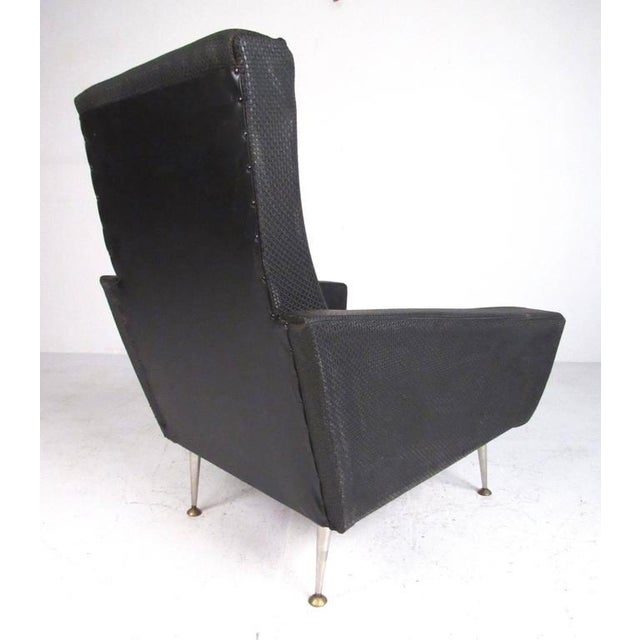Generously proportioned pair of modernhigh back lounge chairs in the manner of Gio Ponti. Covered in a woven/textured...