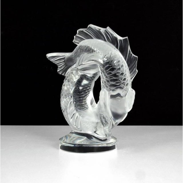 On this large satin crystal figure, originally designed in 1953 by Marc Lalique, the two fish seem to emerge from the...