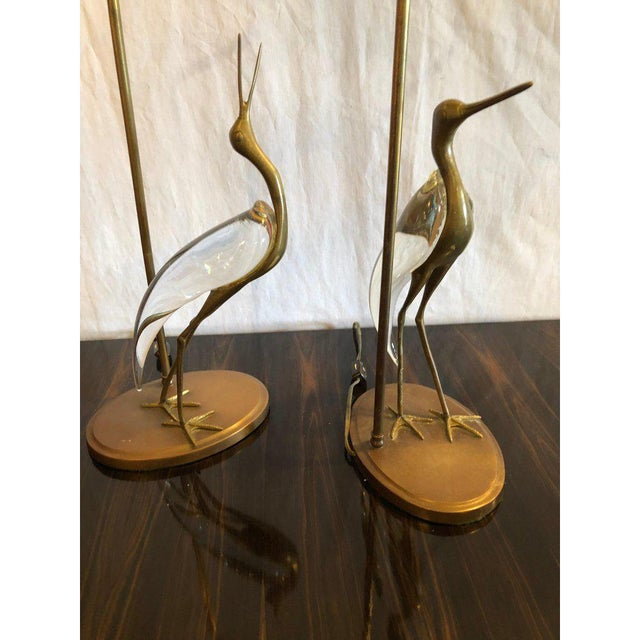 Pair of one of a kind Art Deco crane form bird brass with glass bodied lamps. The birds measure 15.5 inches in height and...