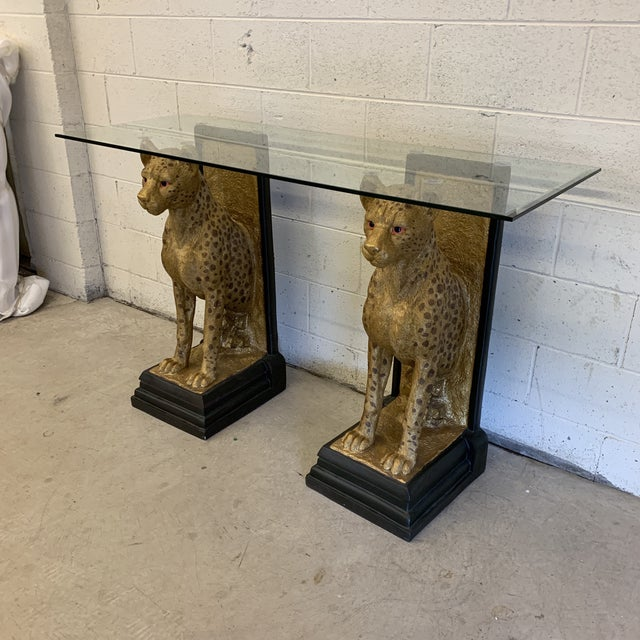 What's new pussycat?! Why, this fantastic double cheetah base console table with nice thick beveled glass top (tempered as...