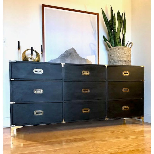This impressive triple dresser made by Carlton House in the 1960's boasts beautiful original brass hardware and recessed...