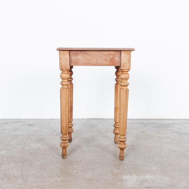 Painted wooden table from late 19th Century France. This piece has a great warm patina. Layers of worn paint create a...