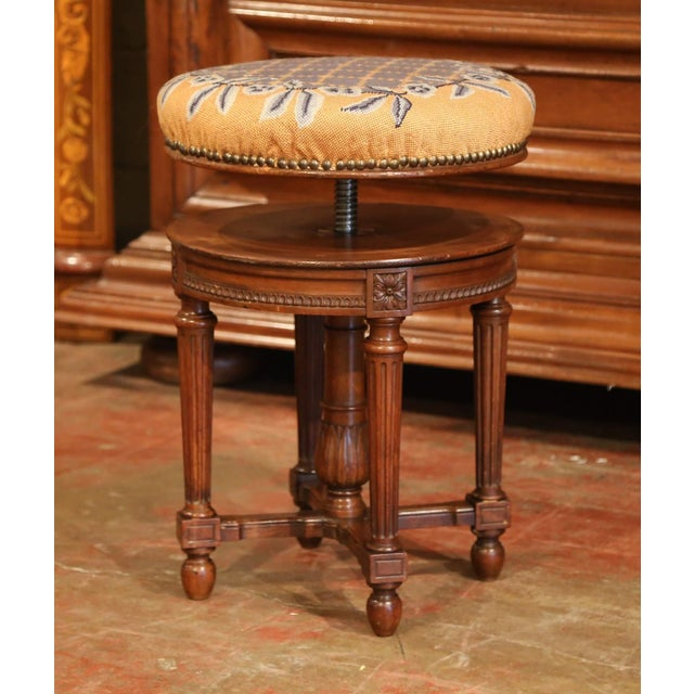 This carved antique fruitwood stool was created in France, circa 1880. Perfect as a piano stool or simply a statement...