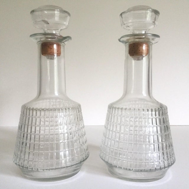 This pair of 2 vintage Mid Century Modern square cut glass decanter bottles are a very special pair to add to your barware...