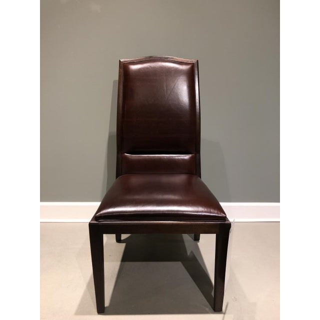 The Danvers Side Chair is a first quality showroom sample that features a dark burgundy leather with a London Brown finish.