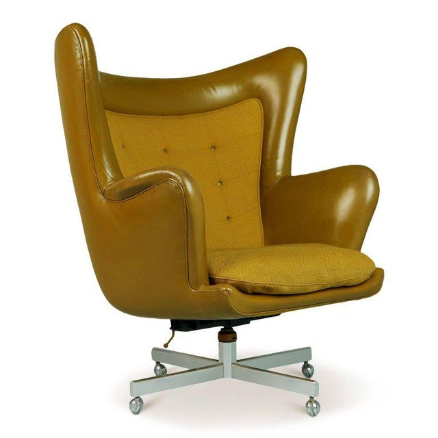 A very rare and impressively proportioned wingback chair by George Kasparian. Perfect for the collector who already has...