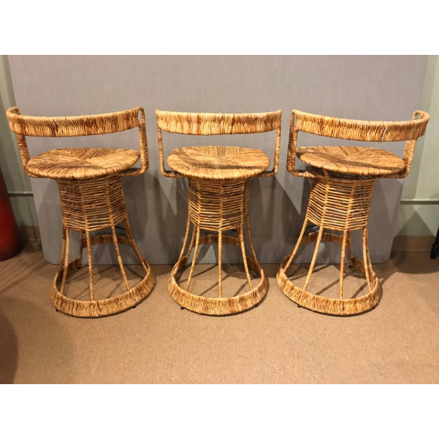 A set of 3 Nautical inspired Cane woven wire Barstools. These would compliment multiple styles from Coastal to Rustic...