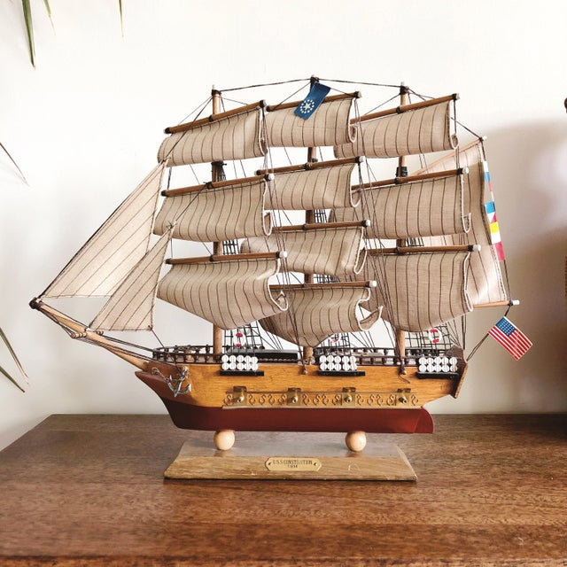 "Vintage wood and brass model ship with fabric sails. The plaque on the wooden base identifies the ship as ""USS..."