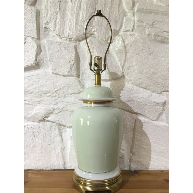 Vintage ginger jar lamp by Frederick Cooper. Mint with brass feet and gold accents. Excellent condition with no signs of...