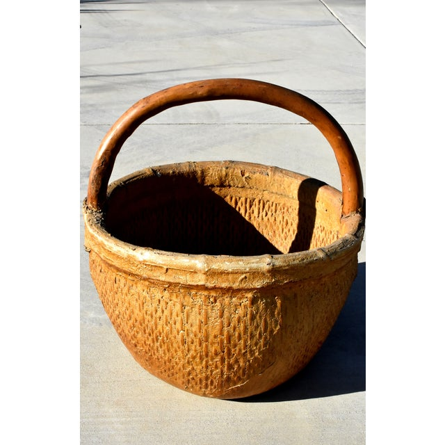 A wonderful antique basket with a tree branch handle and iron bracket enforcement. The willow basket is tightly woven and...