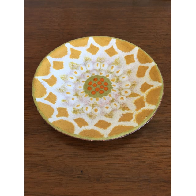 Lovely hand painted trinket tray in mustard yellow, avocado green, white, and orange. Speckled back. This little dish is...