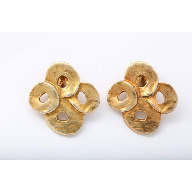 """Four """"gold"""" circle cluster clip earrings signed and dated. H 1.38 in. x W 1.38 in. Due to the unique nature of this..."""