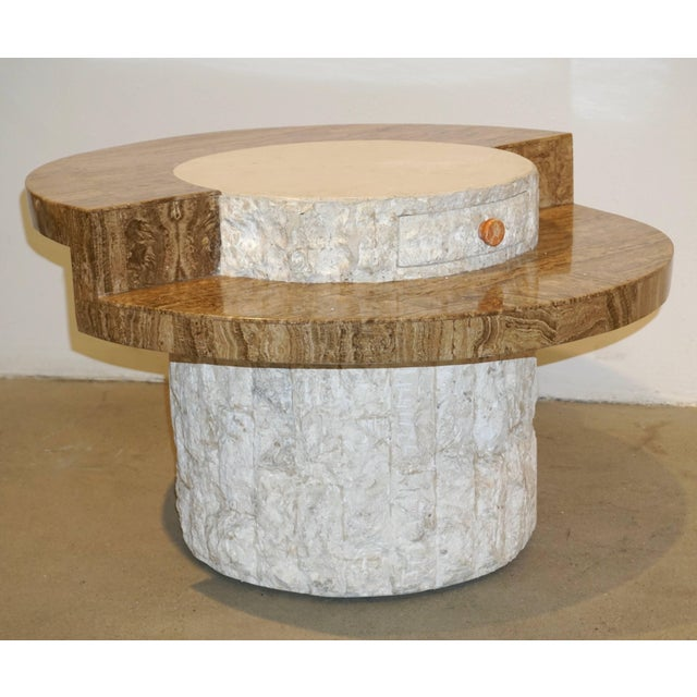 An exclusive Italian design by Marzio Cecchi, this organic end table exquisitely fitted with one drawer, entirely...