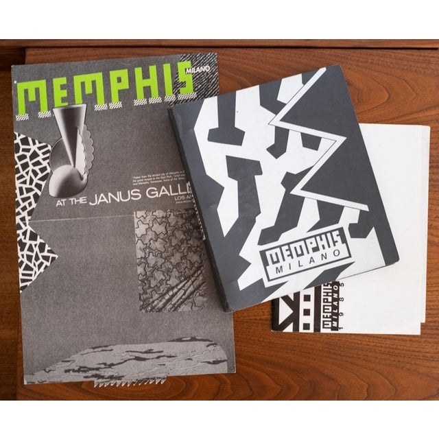 Memphis Milano catalogue set and poster. Includes the collection of furniture, lighting, clocks, carpets, ceramics and...