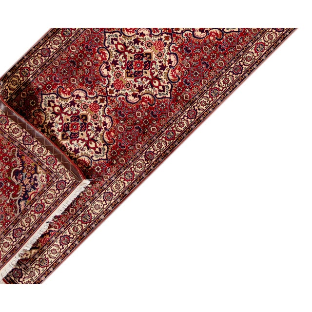 """A 20th century Bidjar runner rug with a red geometric multi-medallion motif. This rug measures at 2'11"""" X 9'11"""""""