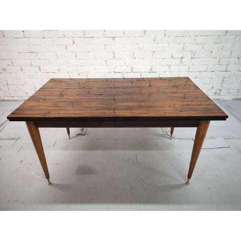 Stunning table with a beautifully polished top with a very specific pattern and 4 fluted pin brass capped legs. The table...
