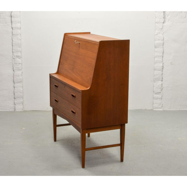 Very nice and practical Scandinavian teak compact writing desk cabinet designed after Gustafsson in the 1960s. This...