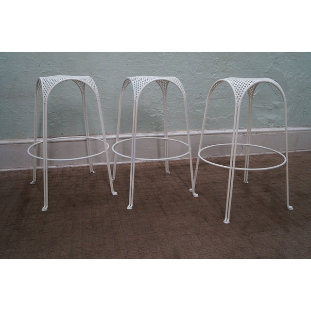 Store Item #: 8837 Mid Century Modern set of 3 painted metal bar stools. Approx 35 years, America. Quality set of 3...