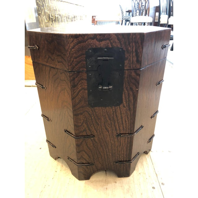 A masculine octagonal oak end table chest that opens to reveal storage inside and is decorated with black iron around the...
