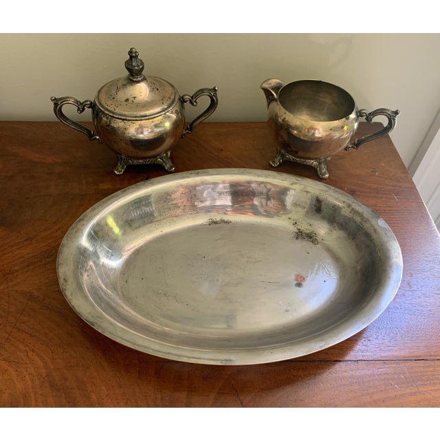 Beautiful antique silver creamer and sugar set with tray. Ornate handles and feet on each piece. Tray could be used as...