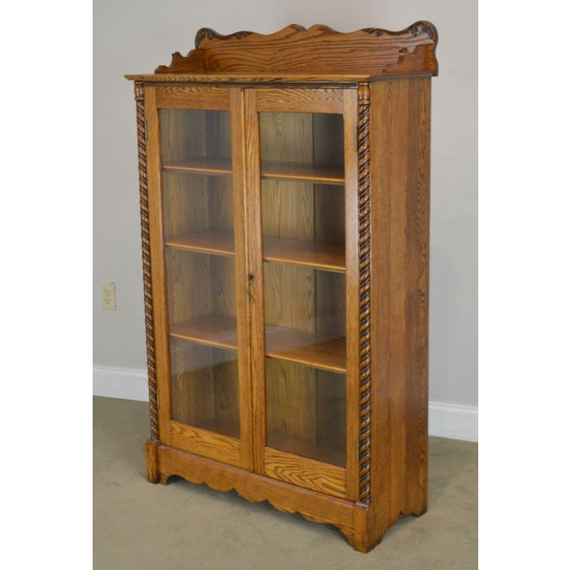 High Quality American Made Solid Oak Victorian Era 2 Door Bookcase with Adjustable Shelves and Key Locking Door