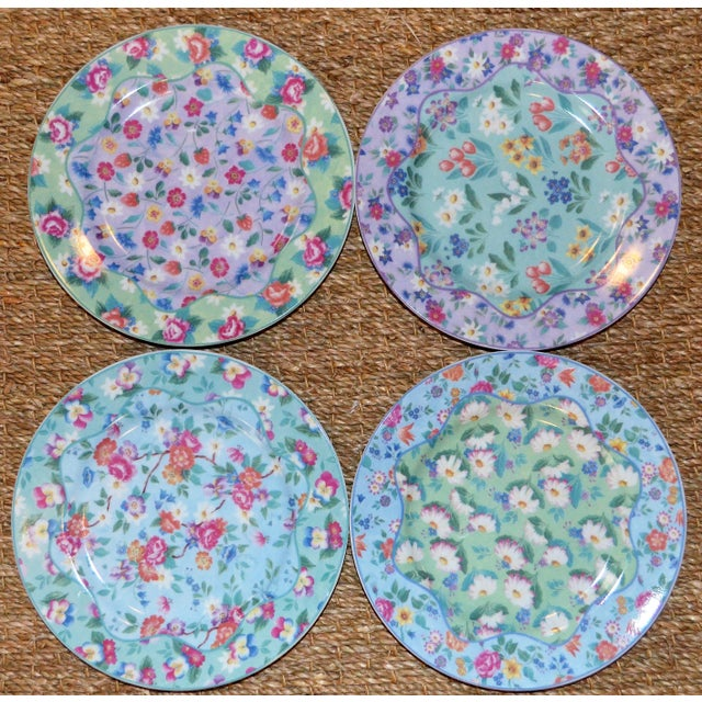 This is a set of four chintz plates in coordinating patterns. The colors are in pretty pink, yellow, green, sky blues....