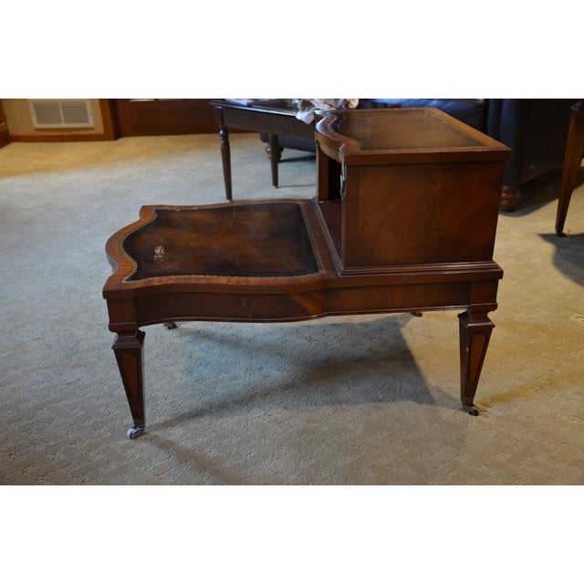Mid Century (Pre-1950), beautiful Weiman Heirloom Quality, step-back leather top end table. There are small wheels on the...