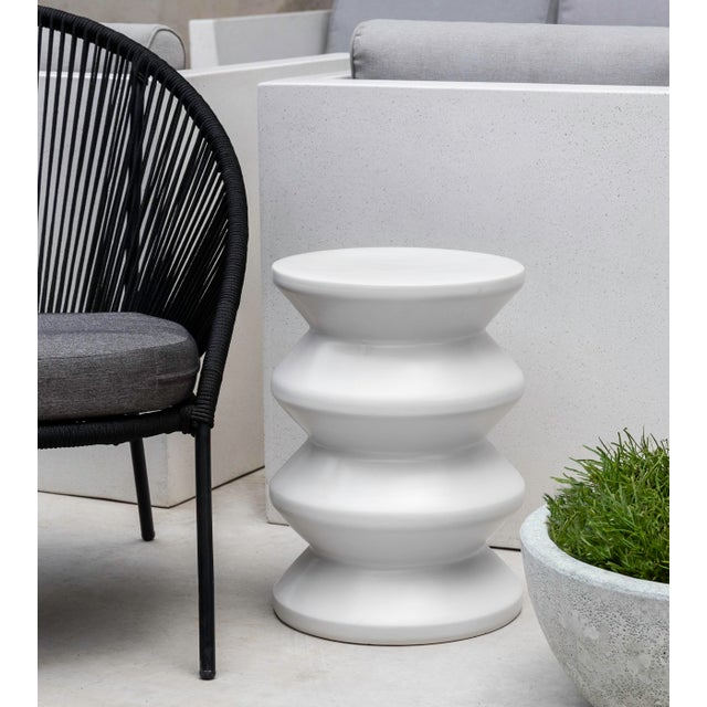 A glazed pottery outdoor accent table or stool in white.