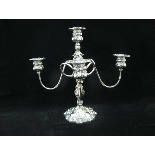 """Striking Art Nouveau design antique candelabra with 4 spiraling arms and 5 candle holders in silverplate. Measures 13""""..."""