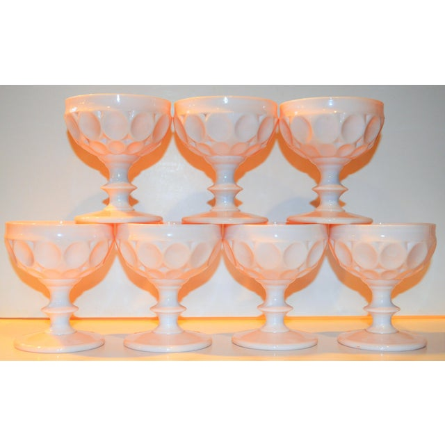 This is a set of 7 thumbprint light pink / blush opaque champagne glasses. They are uber swank and very feminine! They...